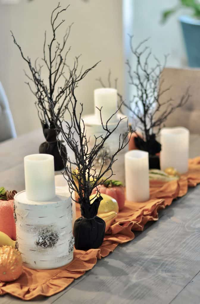 Fall dining table centerpiece with spooky black Halloween trees