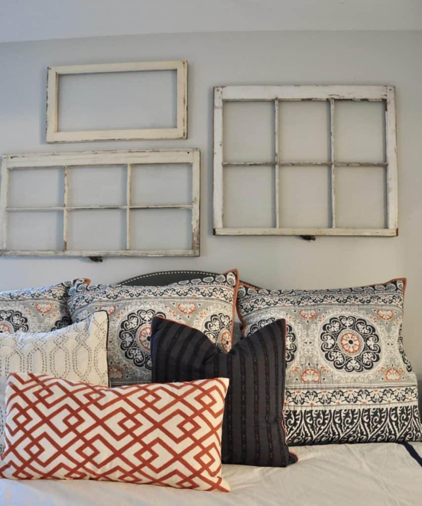 vintage windows as art in bedroom