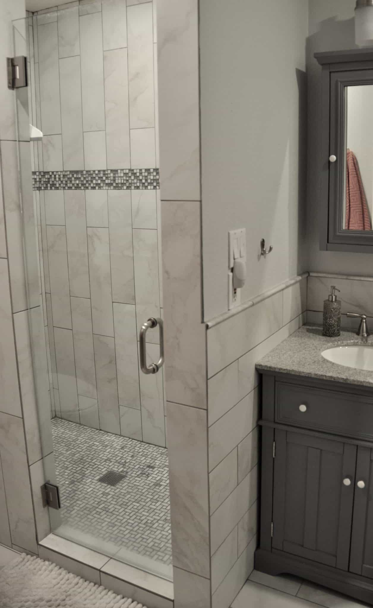bathroom remodel shower update gray and white glass shower door