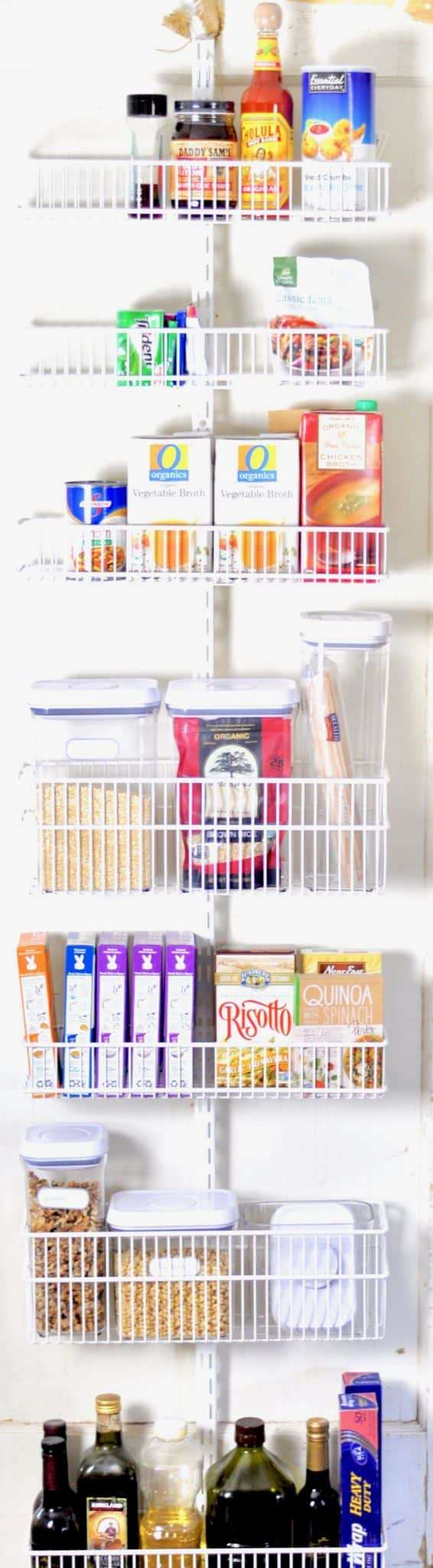 organized pantry door with elf system baskets food storage