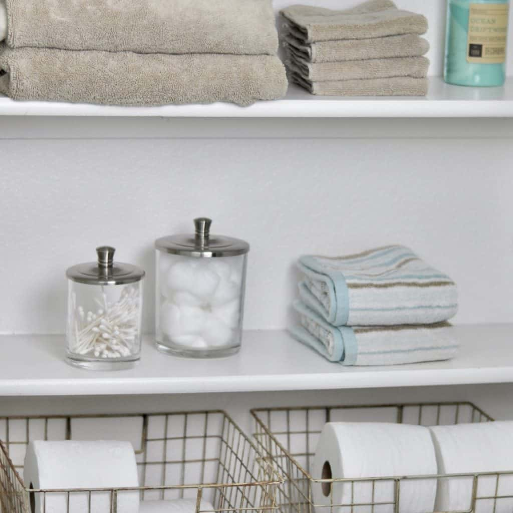 linen closet with organized shelves towels and toilet paper easy simple organized