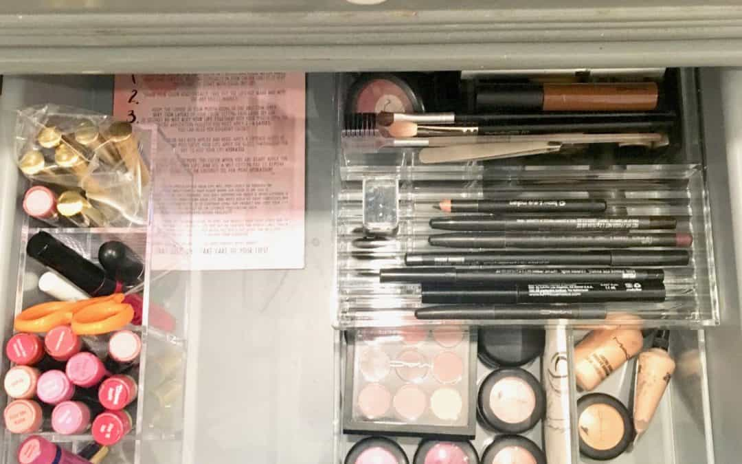 organized makeup in acrylic drawer divider
