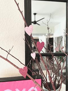 glitter hearts and sticks valentine decor in pitcher